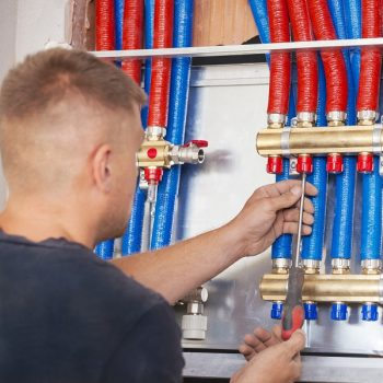 Plumber mounted distributor of central heating. Central Heating Distributor